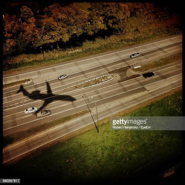High Angle View Of Airplane Shadow On Highway