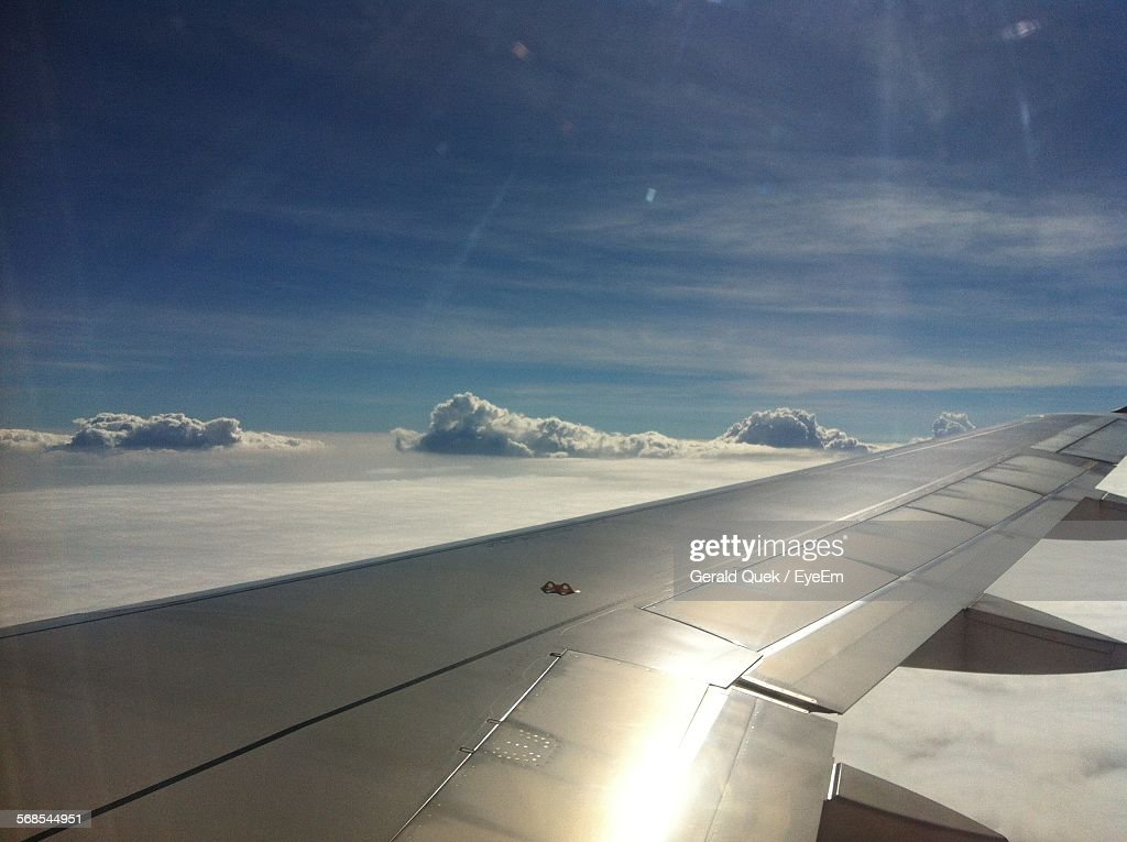High Angle View Of Airplane Wing Against Sky : Stock Photo