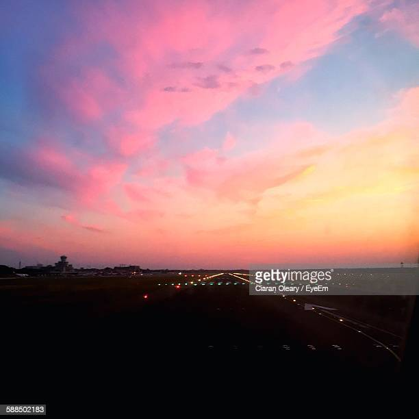 High Angle View Of Airport Runway At Sunset