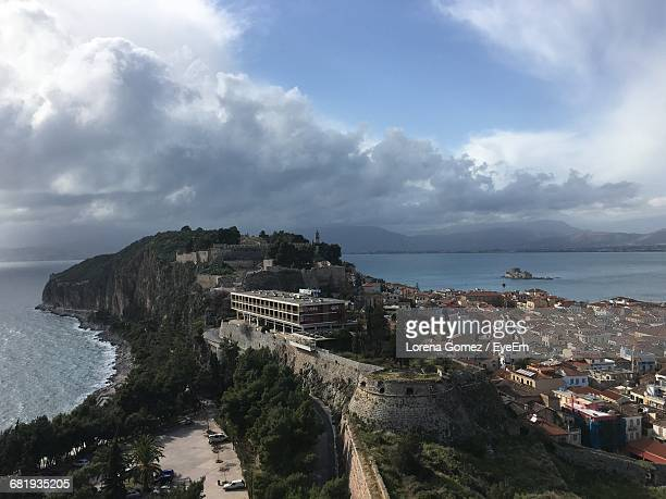 high angle view of akronafplia fortress and sea against cloudy sky - lorena gomez fotografías e imágenes de stock