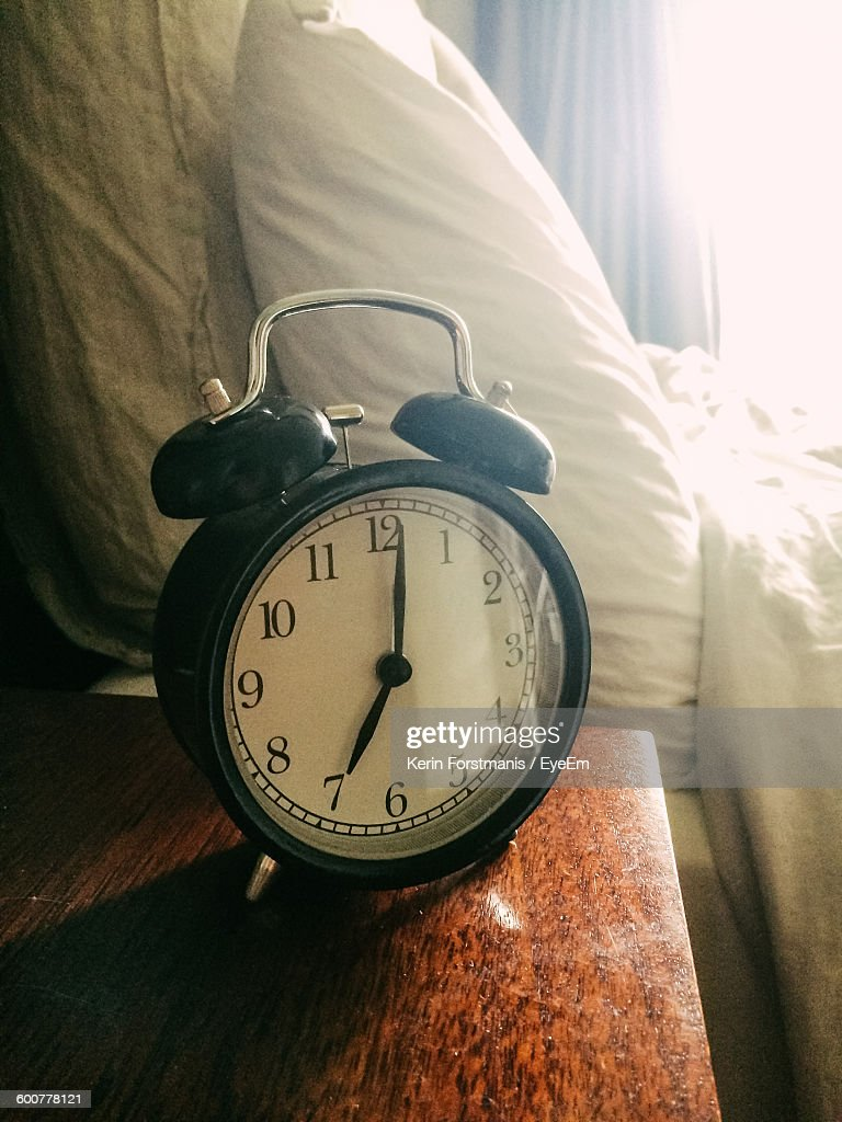 High Angle View Of Alarm Clock On Table At Home : Stock Photo