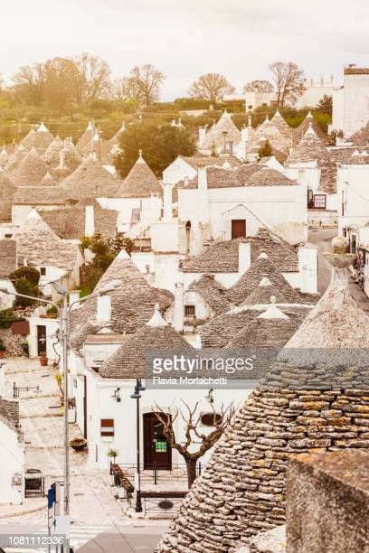 high angle view of alberobello's 'trulli' buildings - alberobello stock pictures, royalty-free photos & images