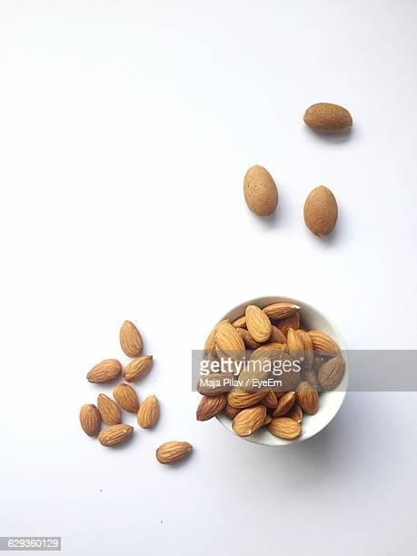 High Angle View Of Almonds In Bowl Against White Background