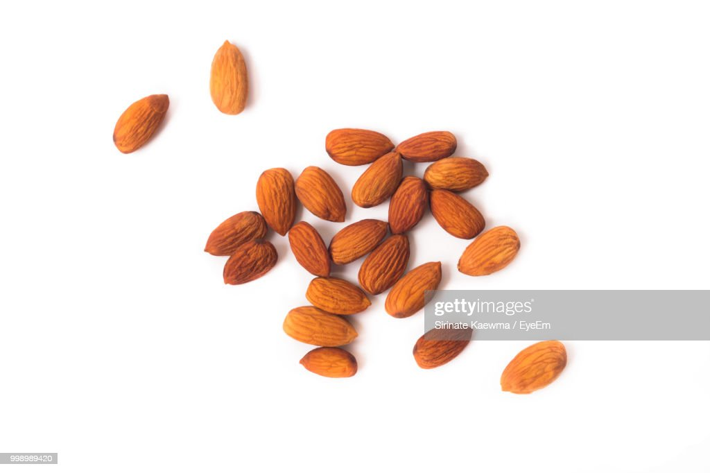 High Angle View Of Almonds On White Background : Stock Photo
