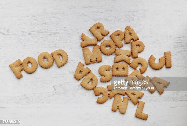 High Angle View Of Alphabet Cookies On Table