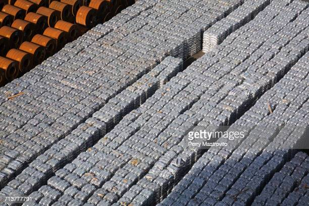 High angle view of aluminium ingots and coiled steel waiting for shipment at port