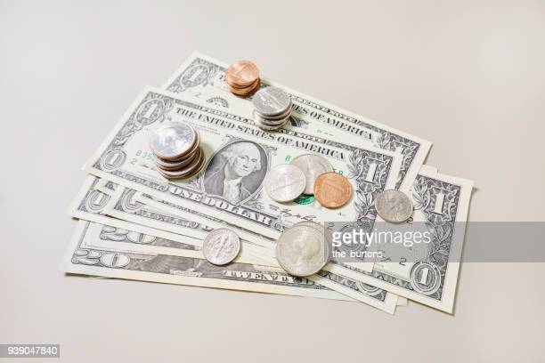 High angle view of American Dollar banknotes and coins