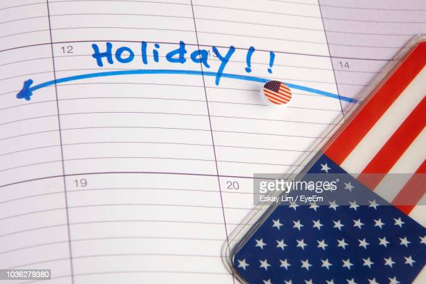 High Angle View Of American Flag Icon On Open Diary