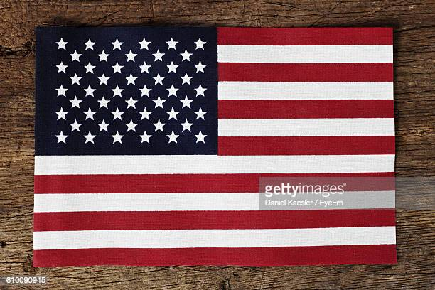 High Angle View Of American Flag On Wooden Table