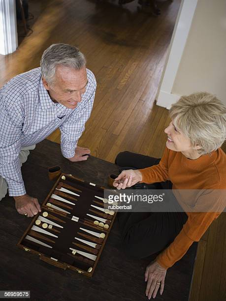 High angle view of an elderly couple playing a board game