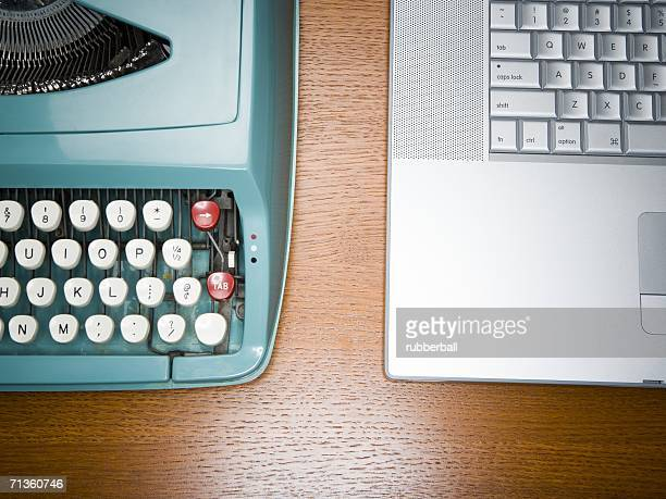 high angle view of an old fashioned typewriter and a laptop on the desk - convenience stock photos and pictures