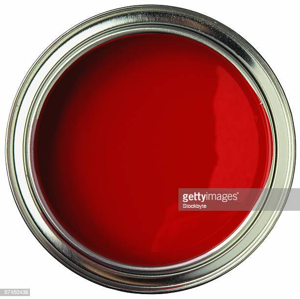 high angle view of an open can of red paint