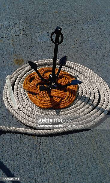 High Angle View Of Anchor And Rope On Boat