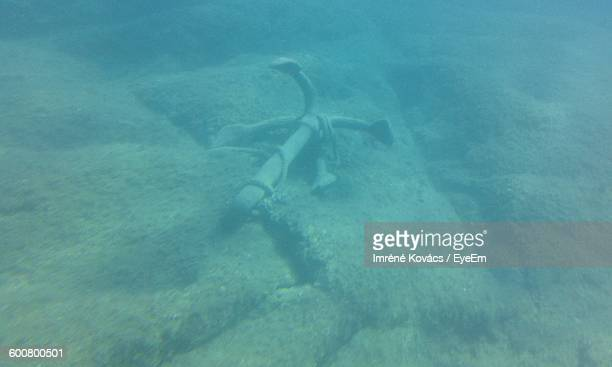 High Angle View Of Anchor In Sea