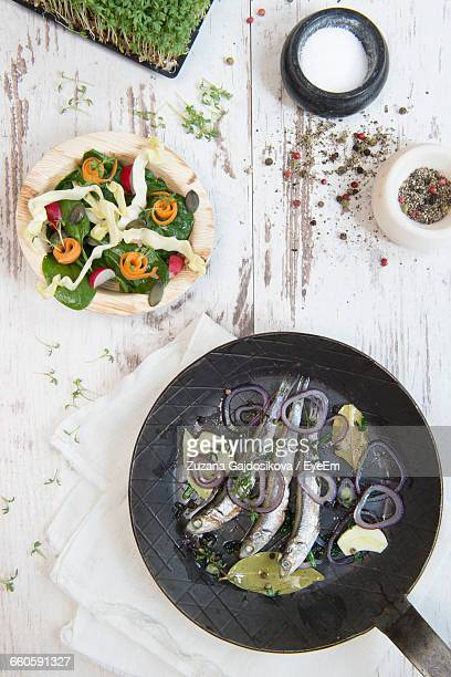 High Angle View Of Anchovies In Cooking Pan On Table