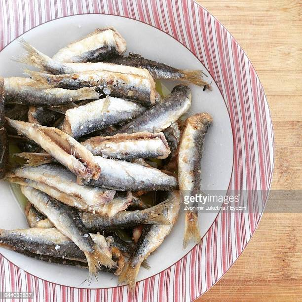 High Angle View Of Anchovies In Plate On Table