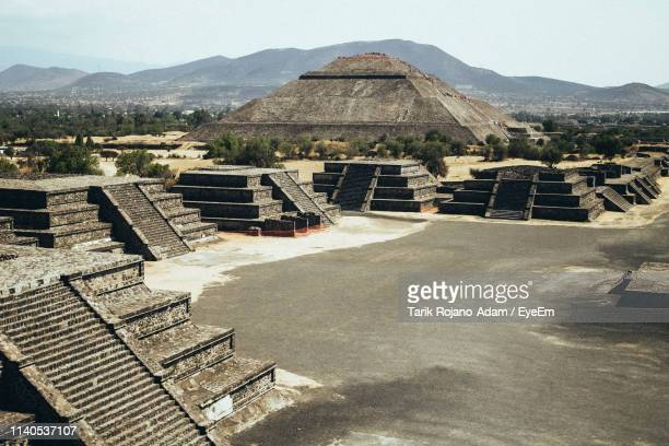 high angle view of ancient pyramids against sky - capital cities stock pictures, royalty-free photos & images
