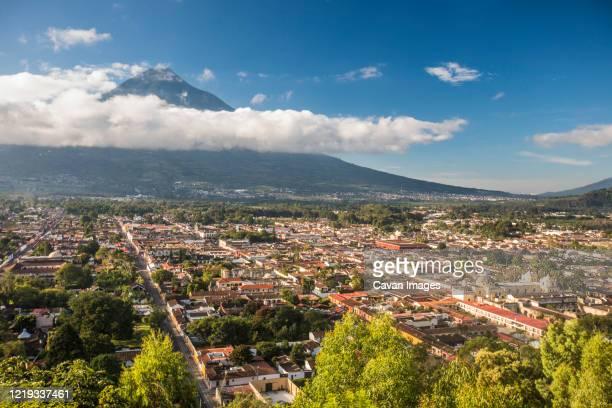 high angle view of antigua, guatemala and volcano agua. - guatemala fotografías e imágenes de stock