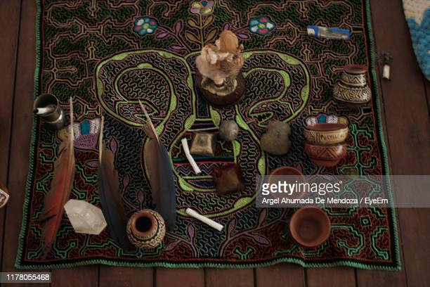 high angle view of antiques on table - argel ahumada stock pictures, royalty-free photos & images