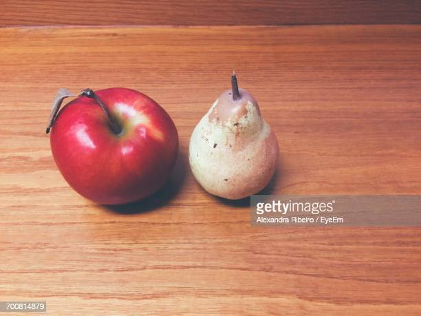 High Angle View Of Apple And Pear On Table