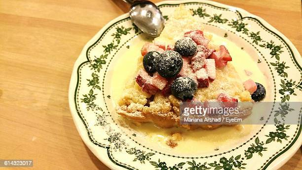 High Angle View Of Apple Crumble Served In Plate On Table