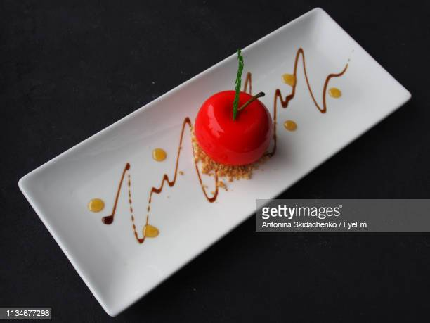 High Angle View Of Apple In Plate Over Black Background