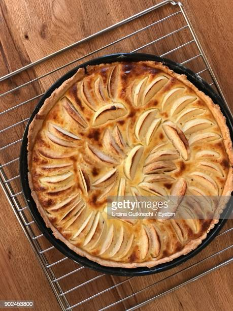 High Angle View Of Apple Pie In Plate On Table