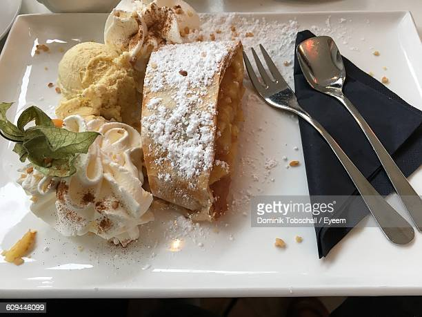 High Angle View Of Apple Strudel Served With Ice Creams In Plate