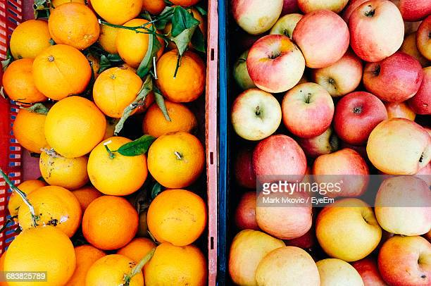 High Angle View Of Apples And Oranges In Container At Market For Sale