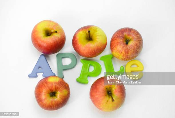 high angle view of apples on white background - frische stockfoto's en -beelden