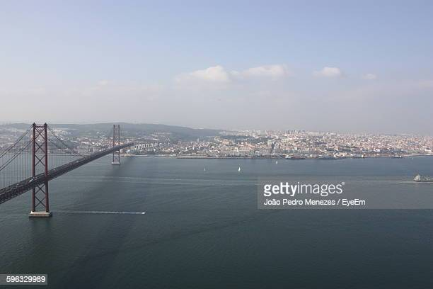 High Angle View Of April 25Th Bridge Over Tagus River Against Sky