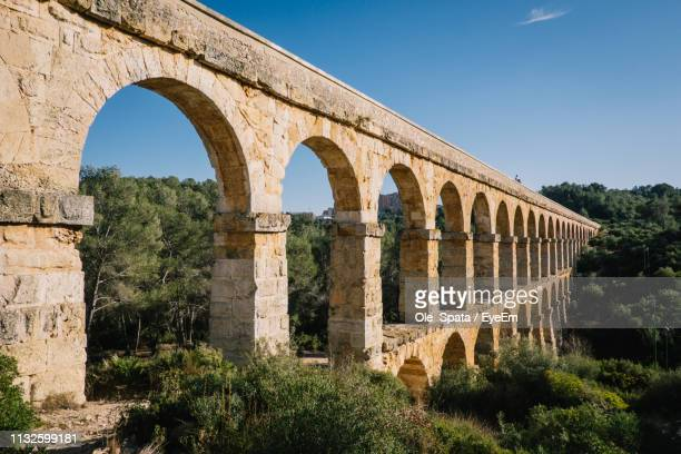 High Angle View Of Aqueduct Against Blue Sky