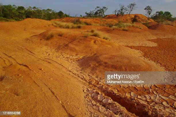 high angle view of arid landscape - muhamad nasrun stock pictures, royalty-free photos & images