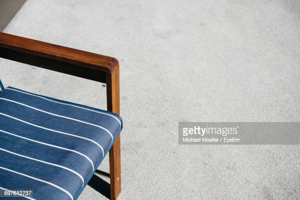 High Angle View Of Armchair On Concrete Floor
