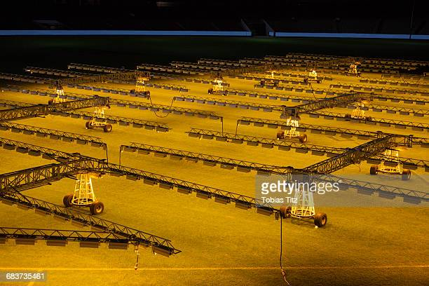 high angle view of artificial lights on soccer field - football bulge stock photos and pictures