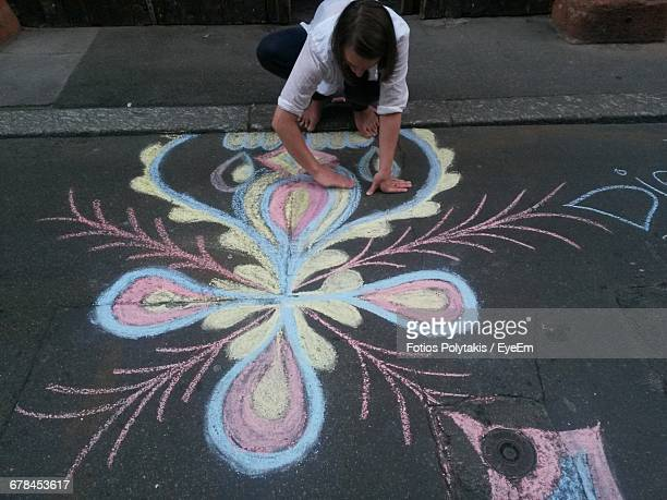 high angle view of artist drawing on street with chalk - chalk art equipment stock pictures, royalty-free photos & images
