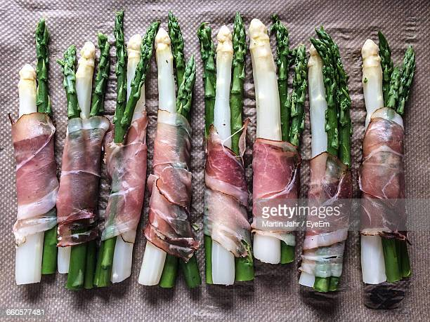 High Angle View Of Asparagus Rolled In Bacon