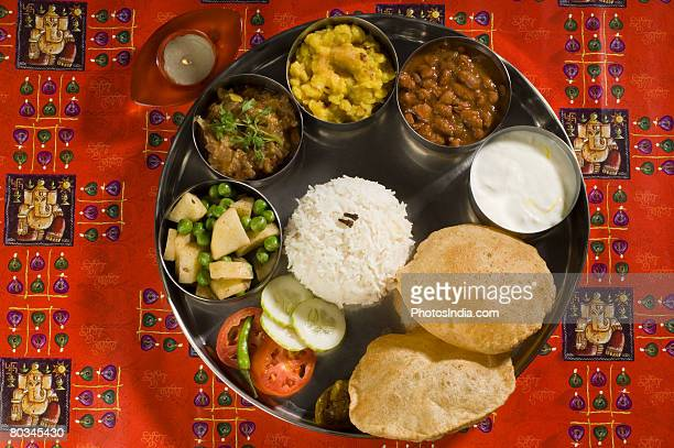 High angle view of assorted Indian food