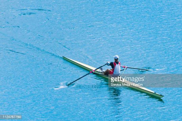 high angle view of athlete rowing on sea - competitive sport stock pictures, royalty-free photos & images