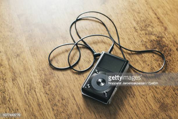 high angle view of audio equipment on wooden table - mp3 player stock pictures, royalty-free photos & images