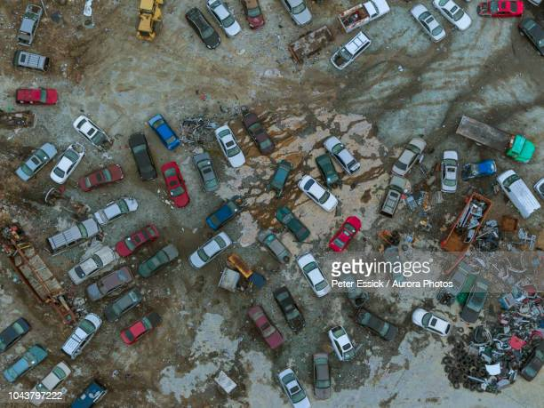 high angle view of auto parts yard - junkyard stock photos and pictures