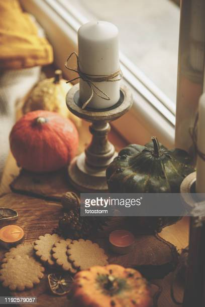high angle view of autumnal items by the window - embellishment stock pictures, royalty-free photos & images