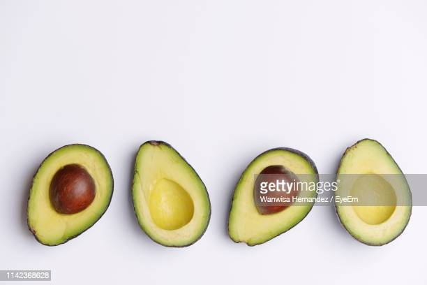high angle view of avocados against white background - avocado stock pictures, royalty-free photos & images