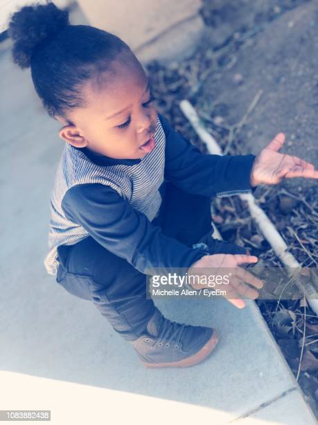 High Angle View Of Baby Boy Playing Outdoors