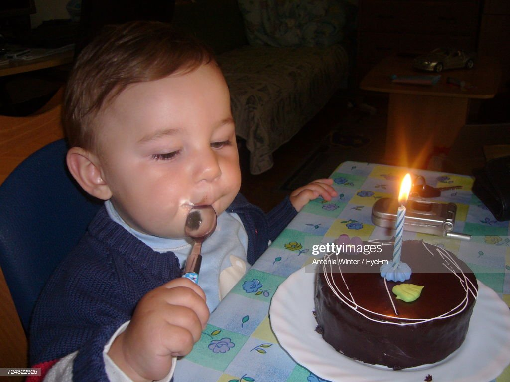 Enjoyable High Angle View Of Baby Boy With First Birthday Cake At Table High Funny Birthday Cards Online Alyptdamsfinfo