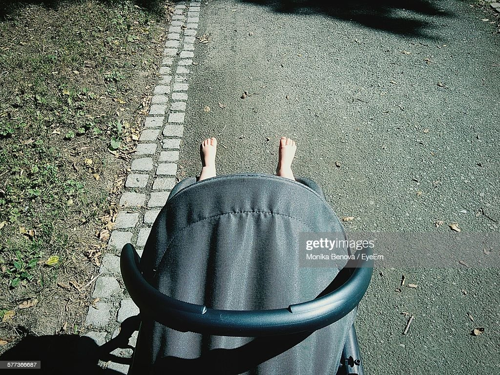 High Angle View Of Baby Carriage On Street : Stock Photo