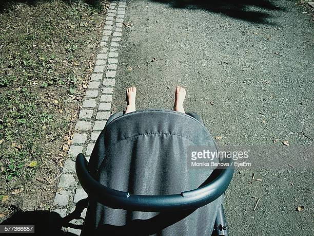 High Angle View Of Baby Carriage On Street
