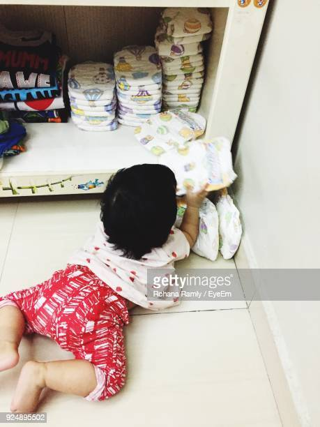 High Angle View Of Baby Girl Playing At Home