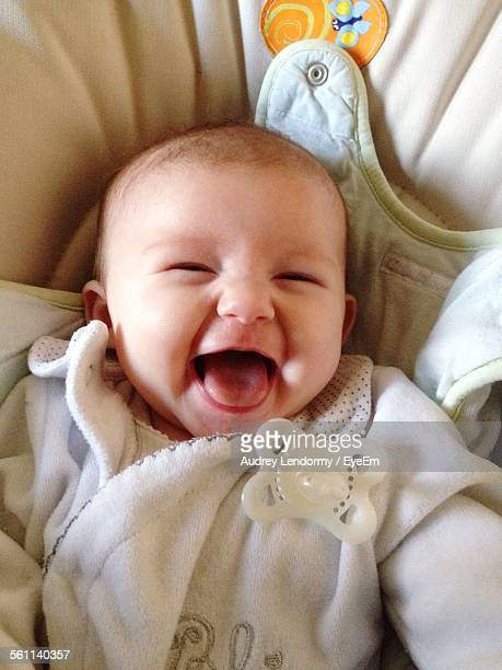 High Angle View Of Baby Laughing