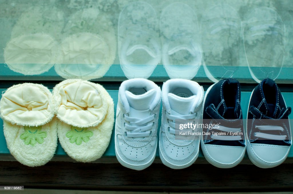 High Angle View Of Baby Shoes On Window Sill : Stock Photo